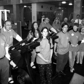 Members of the Board of Governors and other members of the UBC community check out equipment in the fitness centre of the new SRC, 1995
